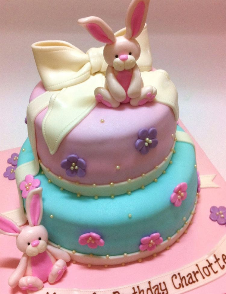 2 tier birthday's cake with bunnies