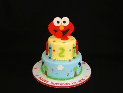 2 tier cake with smiling Elmo