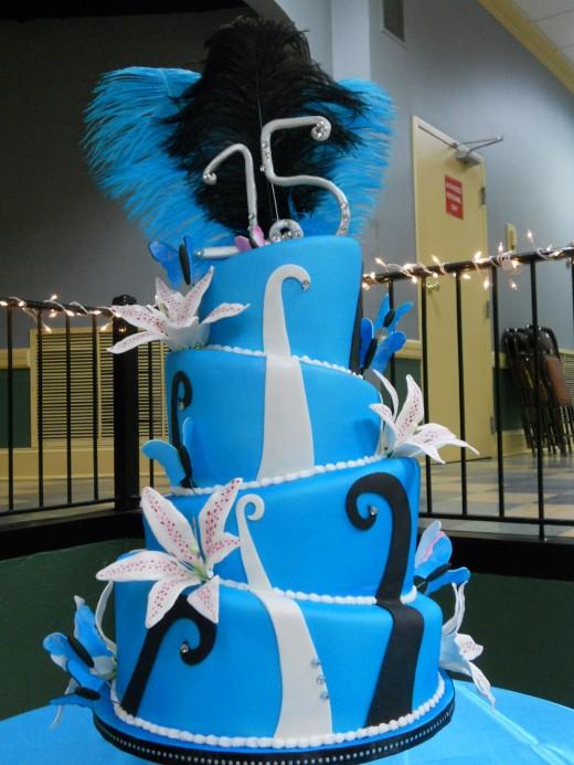 3 tier blue quinceanera cake