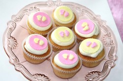 Baby shower cupcakes with feet decorations