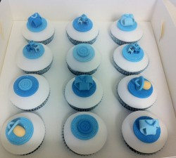 Baby shower cupcakes with blue decorations