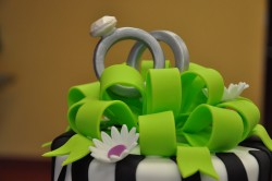 Engagement cake with green ribbon