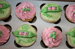 Baby shower cupcakes with child peas