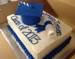 Cake with blue graduation cap