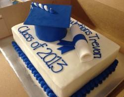Cake with blue graduation cap