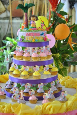 Dora birthday cake with cupcakes