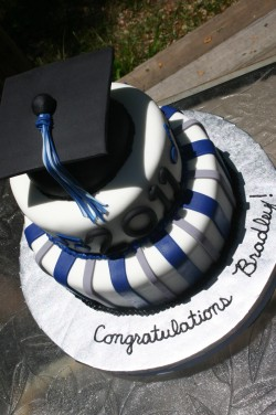 Blue and black graduation cake