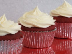Three red velvet cupcakes