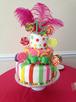 Quinceanera cake with pink feathers