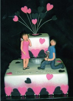 Pink and black hearts engagement cake