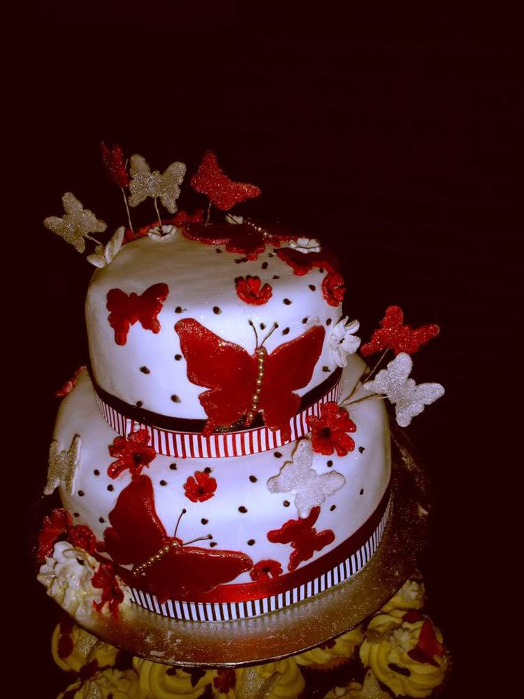 Birthday cake with red butterflies