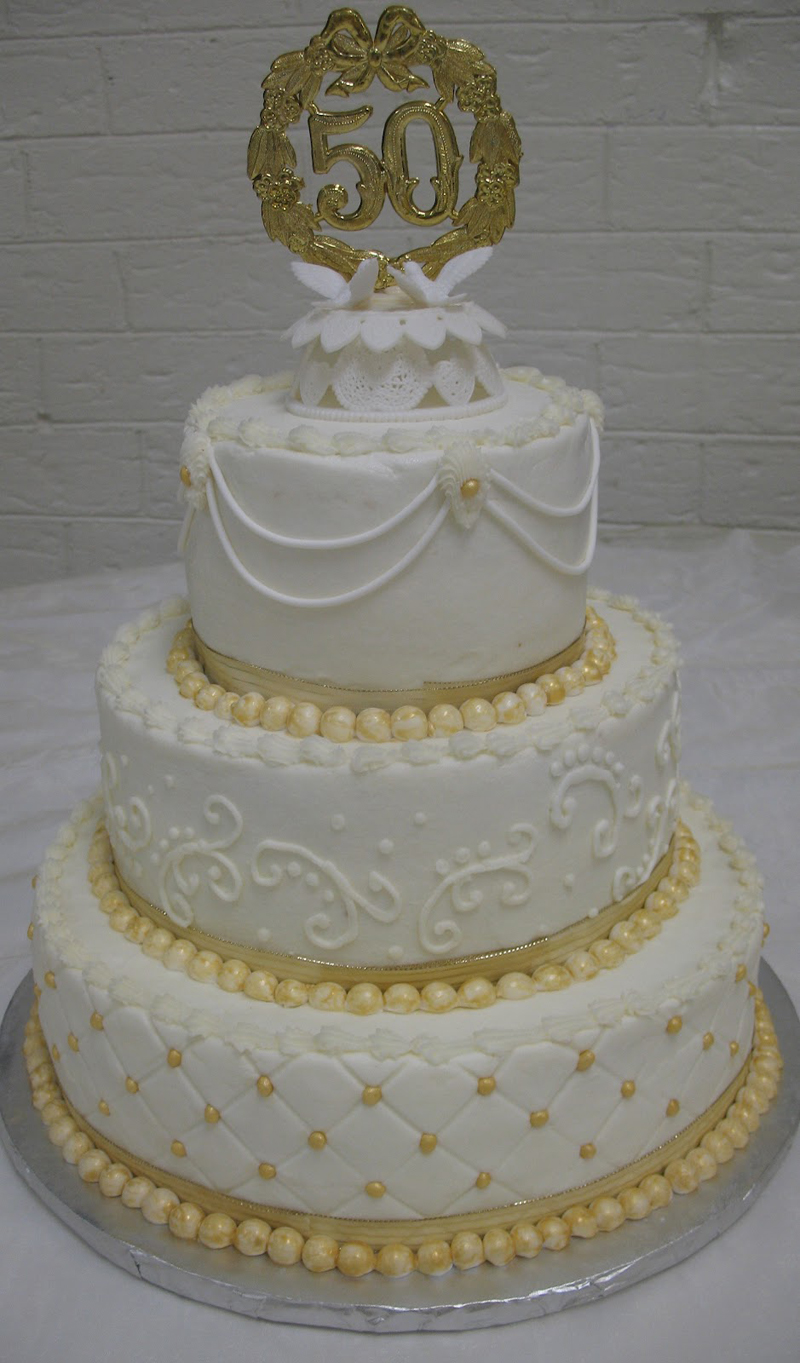 Anniversary cake with gold decoration