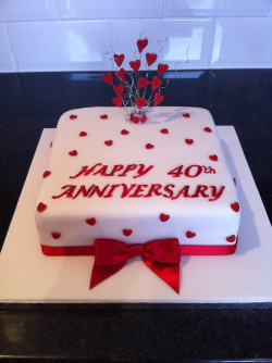 Anniversary cake with red hearts