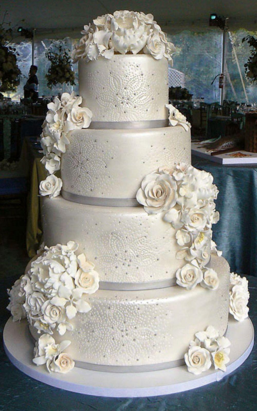 Winter wedding cake with flowers junglespirit Images